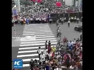 Human wall! Watch how China's armed police direct traffic ...