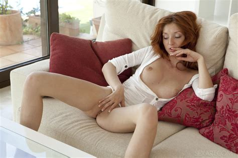 Spunky Redhead Michelle H Spreads Her Legs To Offer A View