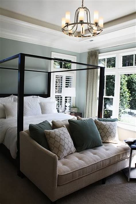sofa at foot of bed blue master bedroom i like the little love seat at the
