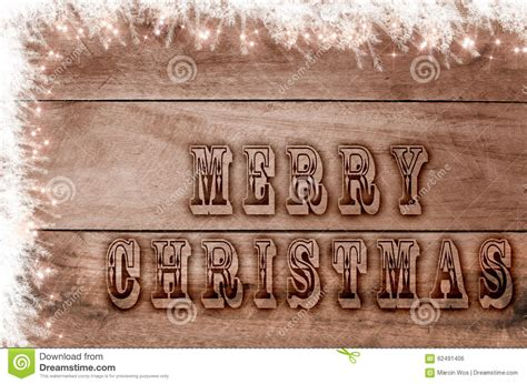 words merry christmas written burned letters  wooden