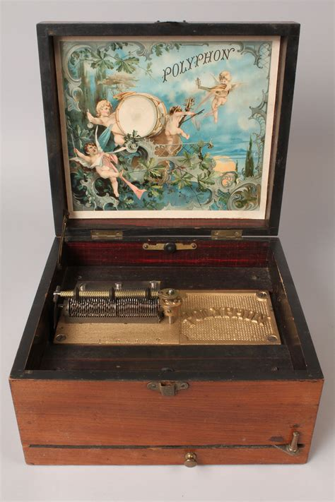 Find the worth of your antique musical boxes and cabinets. Lot 264: Polyphon wooden music box with discs