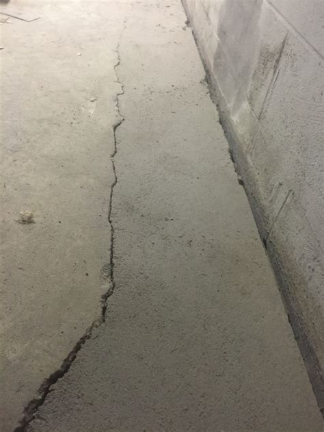 Basement concrete floor heaving/cracking at French drain