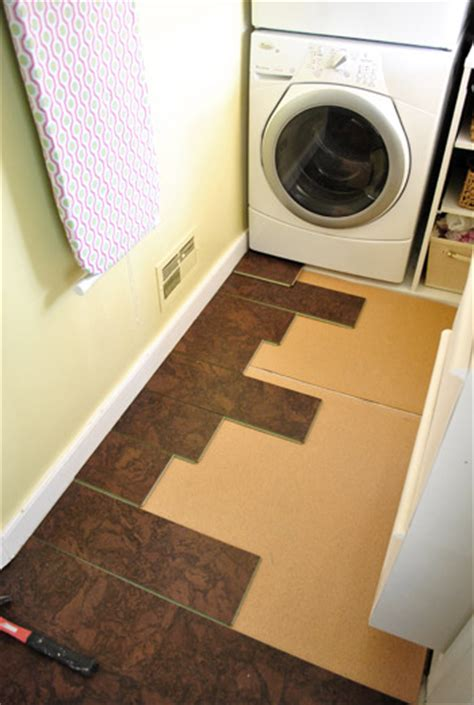 cork flooring laundry room completing our kitchen s cork floor installation young house love
