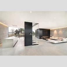 Diamondshaped House With Curving Glass Windows  Modern