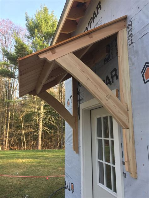 awning barn mortiseandtenon cedar door awnings   porch roof porch awning window