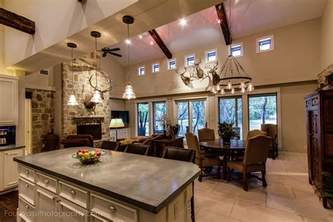 open kitchen floor plan  concrete island counter top custom cabinets  faux stone