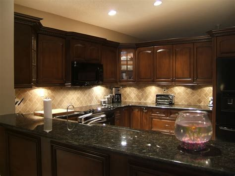 kitchen cabinets with black granite countertops the black quartz countertop with the cabinets 9831