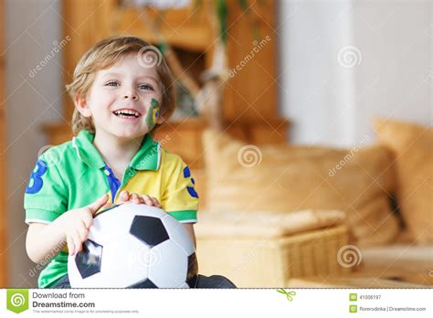 boy football cup on tv stock photo 113 | little boy watching football cup game tv blond preschool years soccer world 41006197