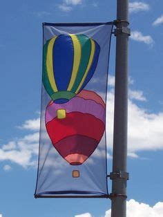 l post banner with wind spilling brackets banners