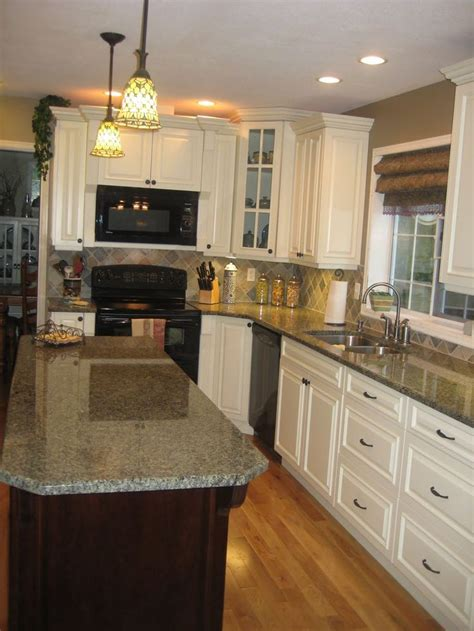 white cabinets  black appliances wood floors google