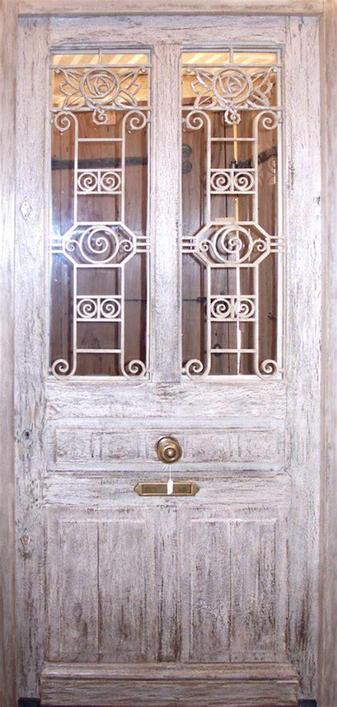oak front door  wrought iron grills front doors