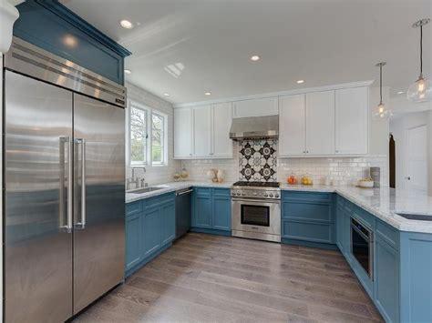 blue and white kitchen cabinets white upper cabinets and blue lower cabinets