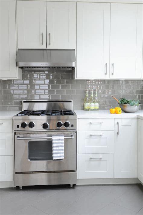 white kitchen  gray floor tiles design ideas
