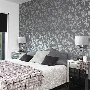 Bedroom with patterned wallpaper designs glass