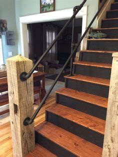 rustic wood stair rail with steel pipe spindles