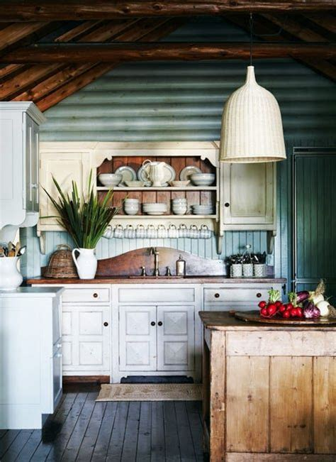 cozy log cabin kitchen  blue painted interior wood