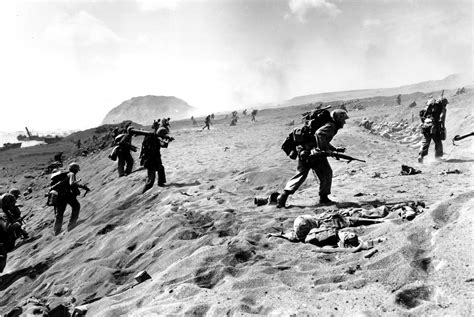 U.s. Fourth Division Marines Move In From The Beach On Iwo