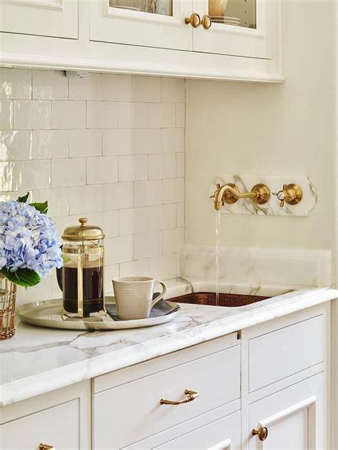 butler pantry  hammered copper sink  wall mount gold spigot faucet transitional kitchen