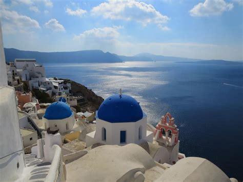 finding  blue domed church  santorini greece