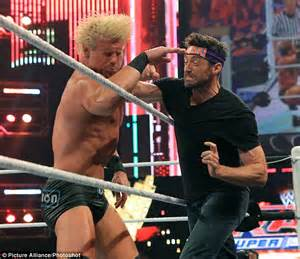Hugh Jackman punches wrestler as he crashes WWE match to ...