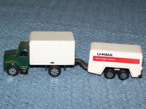 Toy Truck Towing A Toy U-haul Trailer