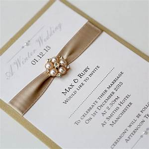 gold ivory flat wedding invitation with pearl brooch With gold and white wedding invitations uk
