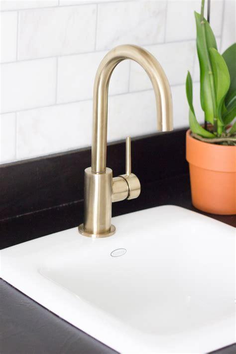 delta trinsic kitchen faucet chagne bronze delta trinsic bar prep faucet erin spain