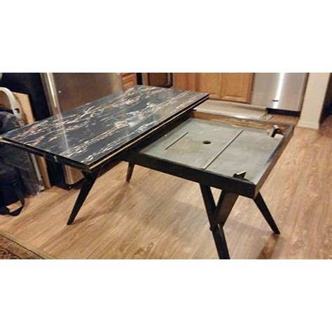 Its overall dimensions are 54″ w x 54″ d x 19″ h. Castro Convertible Coffee/Dining Table | Chairish