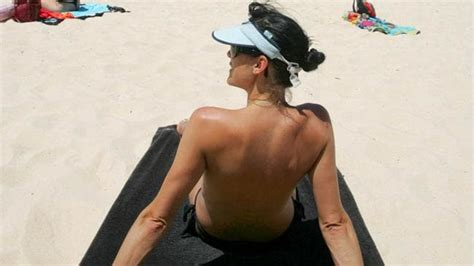 poll finds men  partners  cover  sunbathing