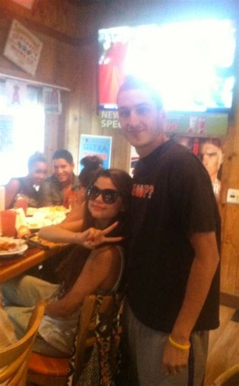 selena gomez spotted  hooters  hollywood gossip