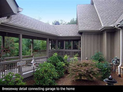 covered deck breezeway leading detached garage steps house home