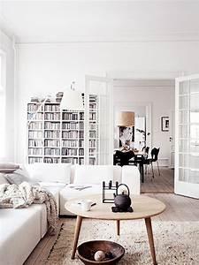 futuristic-white-apartment-with-casual-living-room-in-danish