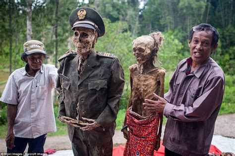 People Dig Up Dead Relatives in Indonesia for Festival