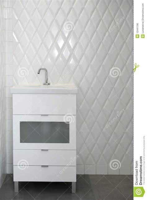 toilet sink   white room diamond shape tiles stock