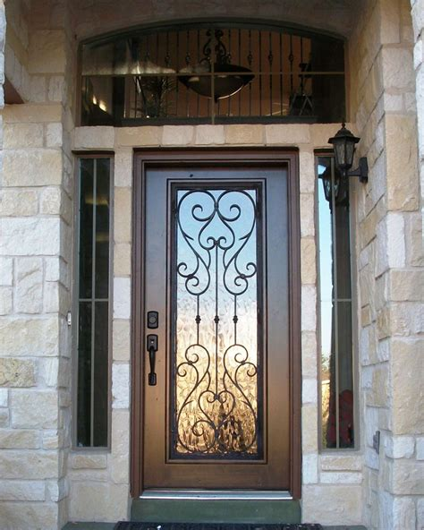 Wood Front Door With Door by Wood And Wrought Iron Door With Transom Front Door Entry