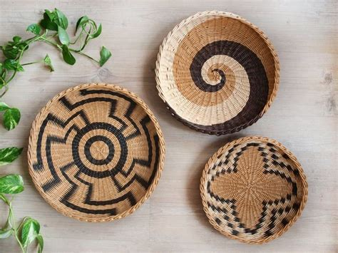 Diy boho basket wall decor. Wall wicker plate wall basket African inspired Wall art Boho   Etsy in 2020   Baskets on wall ...
