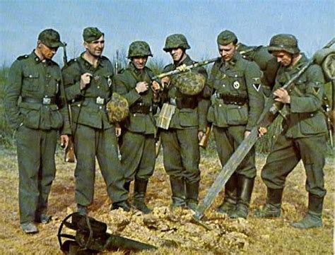 German World War 2 Colour German Soldiers Inspect A Dud