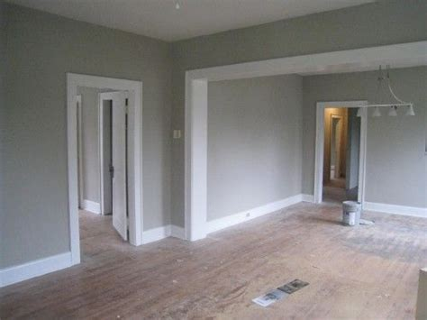 light grey wall paint grey walls white trim wood floor think about this with the black espresso cabinets and light