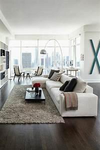 1001 idees pour amenager une chambre en longueur des With tapis de sol avec canapé d angle blanc