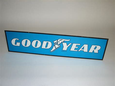 vintage goodyear tires double sided tin garage sign  wing