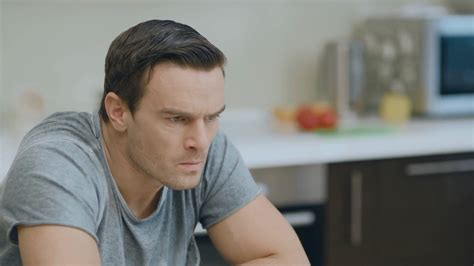 Closeup angry man feeling upset at living room. Annoyed husband arguing with wife at kitchen ...