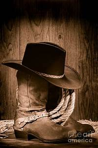 Cowboy Hat And Boots Photograph by Olivier Le Queinec