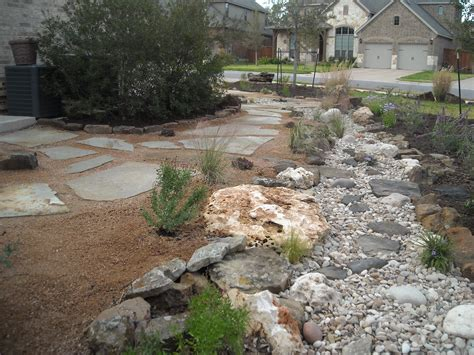 front yard landscape creek bed with a