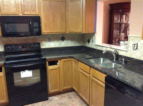 Kitchen Granite Pictures Granite Backsplash by Kitchen Quartz Countertops With Oak Cabinets Black