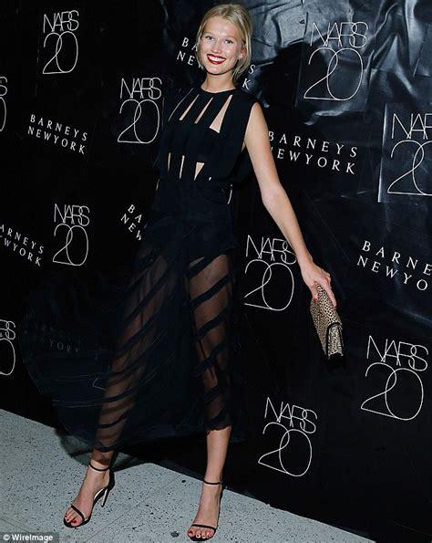 toni garrn shows long legs  sheer skirt  nars