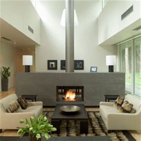 living room with fireplace in the middle fireplaces middle and the room on