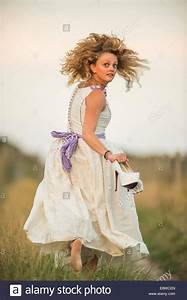 The runaway bride - a young woman girl in a wedding dress ...