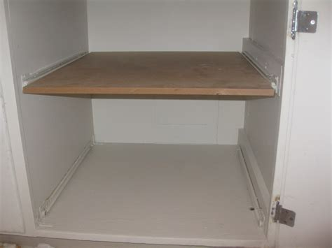Install Shelves In Closet by White Wooden Cabinet With Simple Custom Diy Pull Out