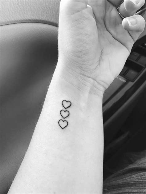 Finally got my tattoo. Three hearts to represent my kids
