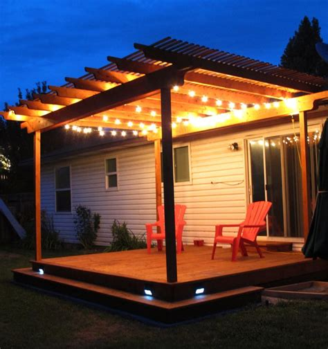 awesome pergola deck with wraparound step and strand lighting it also has solar powered stair